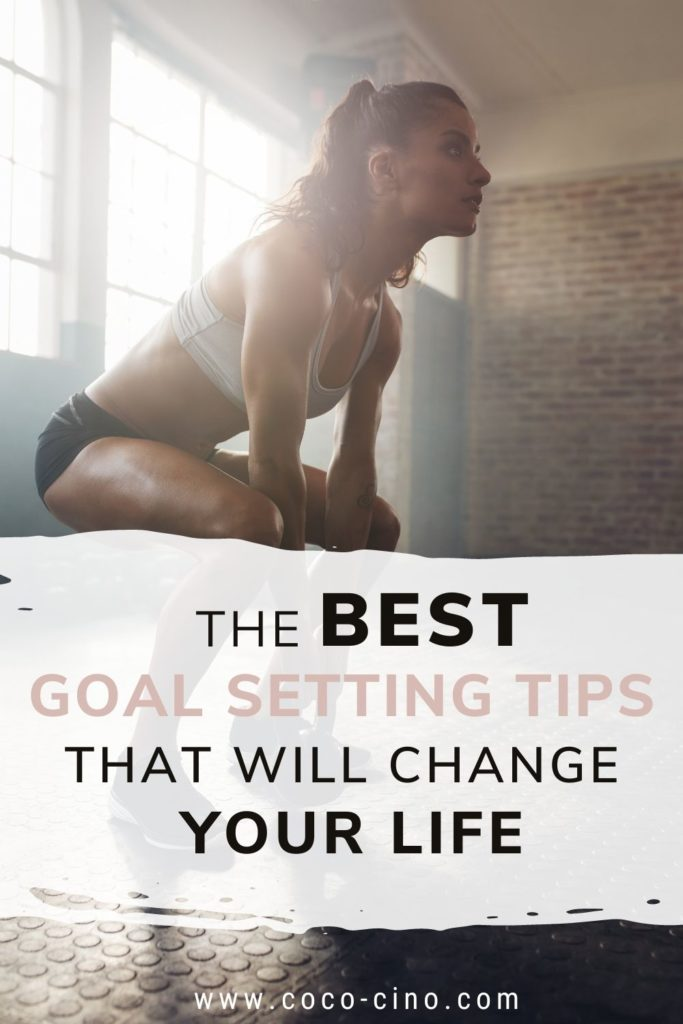 Ultimate Guide to Goal Setting_girl in gym lifting weights