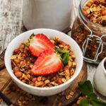 DIY_3 crunchy granola ideas_Granola in Bowl topped with strawberries