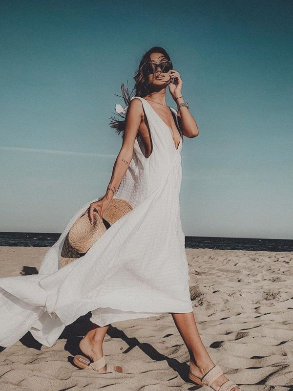 Girl in an airy white beach maxi dress