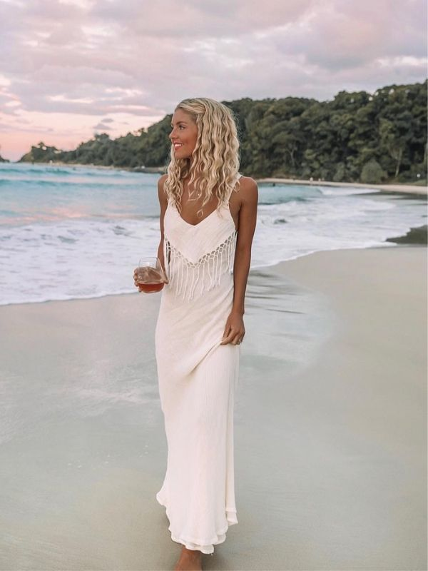 Girl in a white Beach Maxi Dress with spaghetti straps