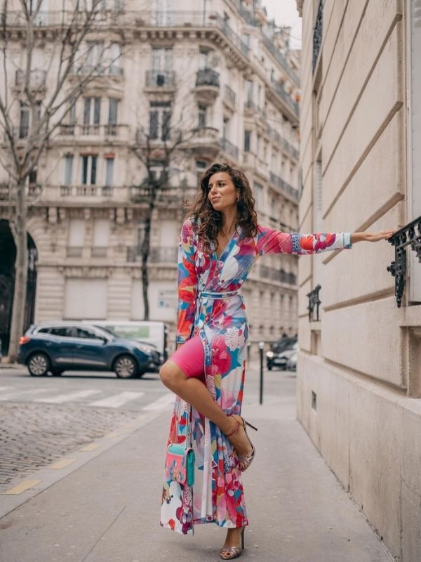 Girl in a floral pink maxi dress with biker shorts