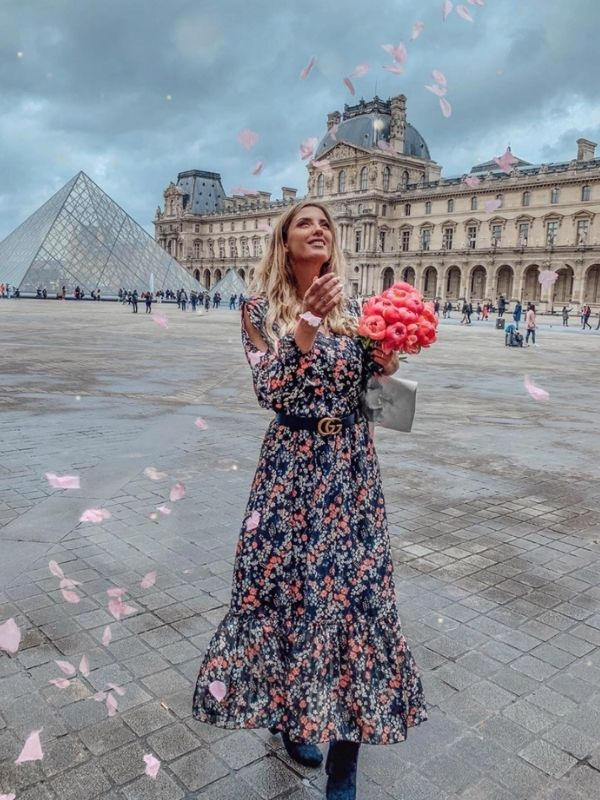 Girl in a Parisian Style Maxi dress with long sleeves with black and pink flowers
