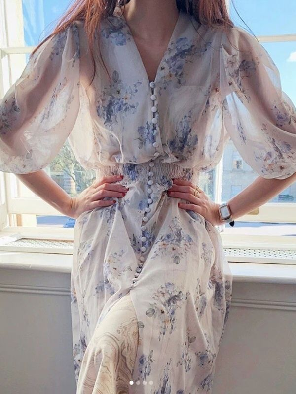 Girl in a White Chiffon Maxi Dress with blue flowers
