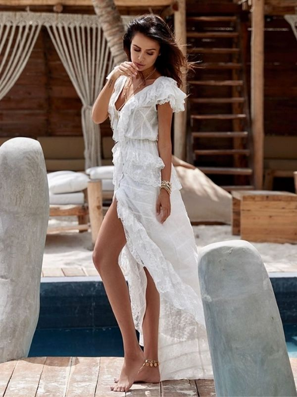 Girl in a white beach dress with flounces