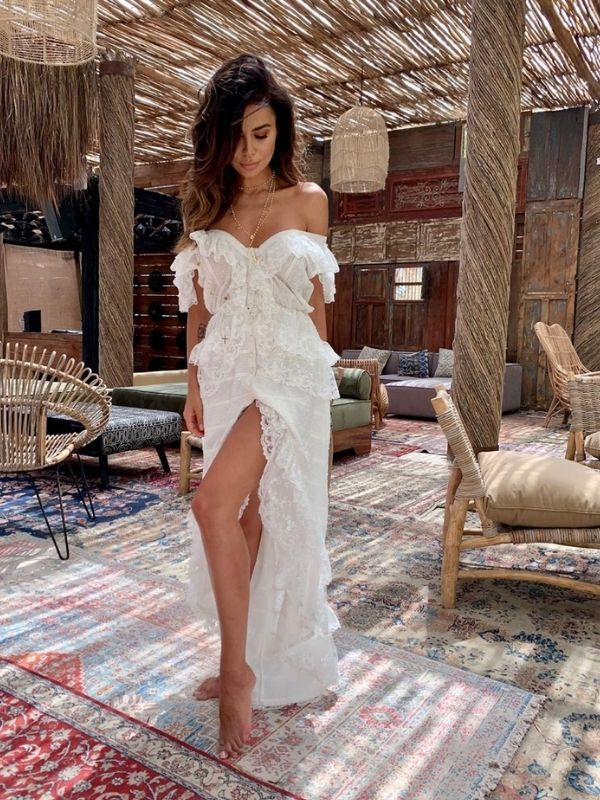 Maxi Dresses_Girl in a white off-shoulder beach dress