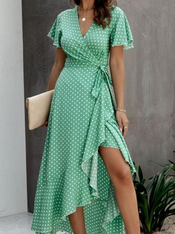 Girl in a Wrap Dress in green with white dots
