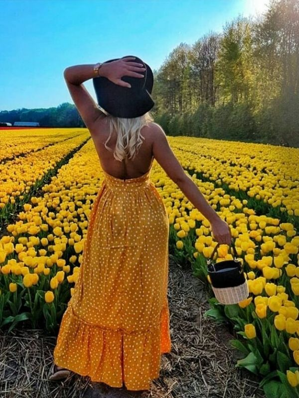 girl in a back-free yellow dress with white dots