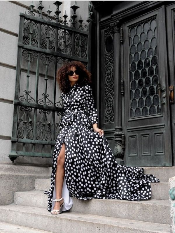 Woman in a black dress with white dots and log sleeves_dress with exceptional pattern