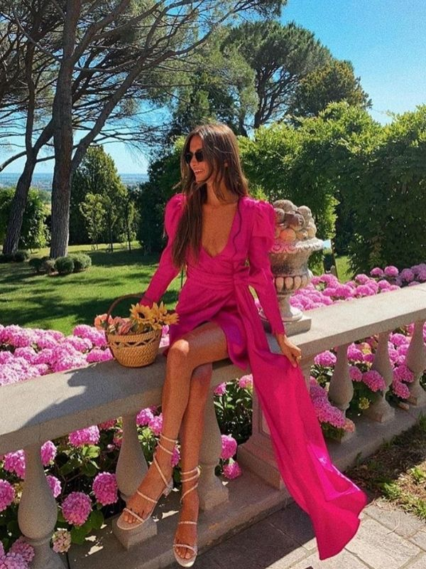 Maxi Dresses_girl in a bright pink wrap dress with long sleeves