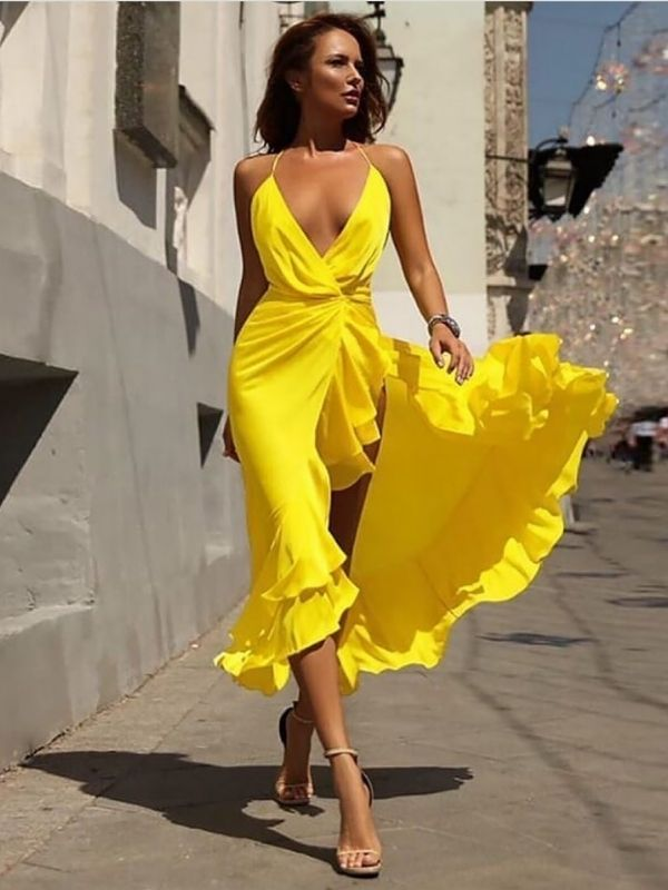 Maxi Dresses_girl in a bright yellow dress with spaghetti straps and flounces