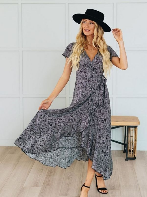 Maxi Dresses_girl in a dark blue wrap dress with white dots