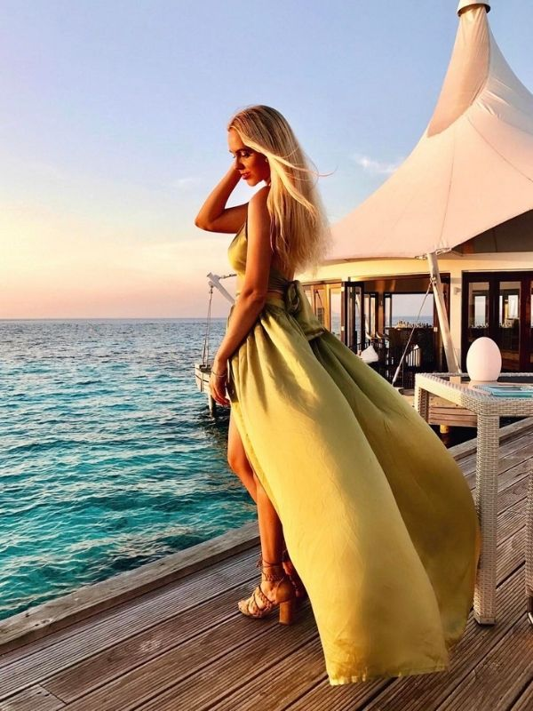 girl in a beautiful golden maxi dress with slit