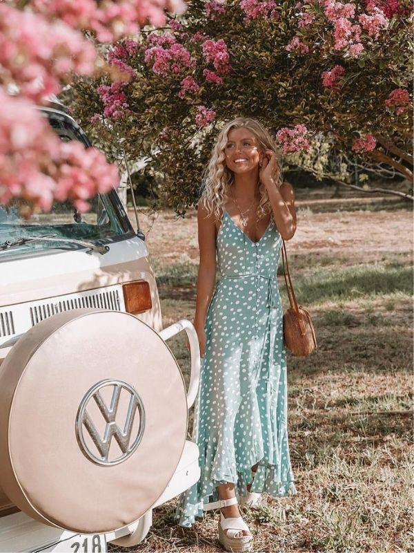 Girl in a light blue summer dress with white dots