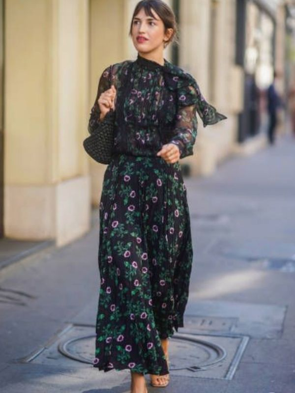 Girl in a parisian style black maxi dress with pink flower print