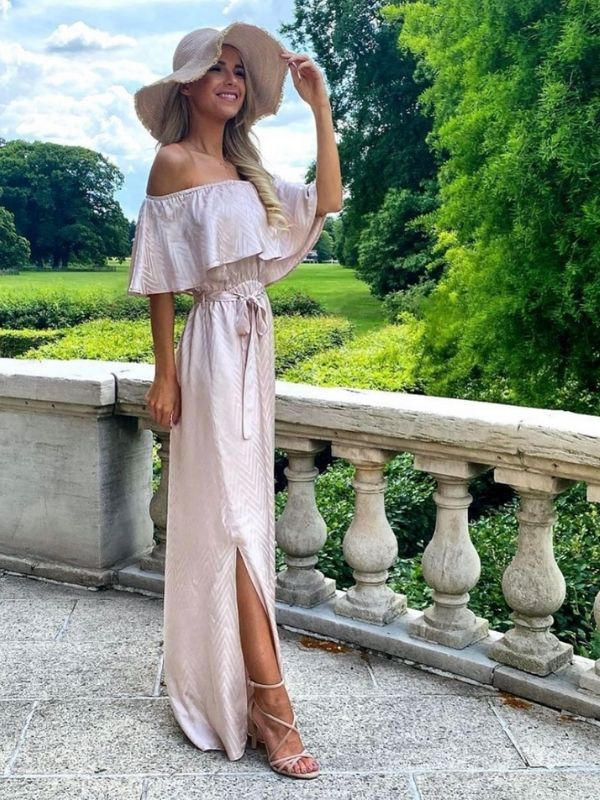Girl in a rose off-shoulder maxi dress and big hat