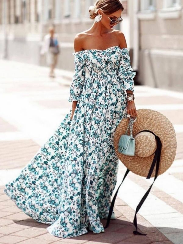 girl in width floral maxi dress in turquois and white
