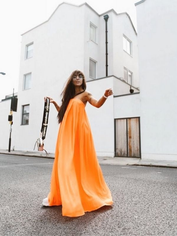 Maxi Dresses_girl in a width orange off-shoulder dress