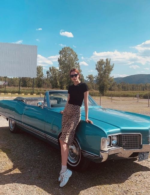 Beautiful leopard skirt_Must-Have_Leopard Skirt_Animal Print_Girl with Leo Skirt in front of a blue car