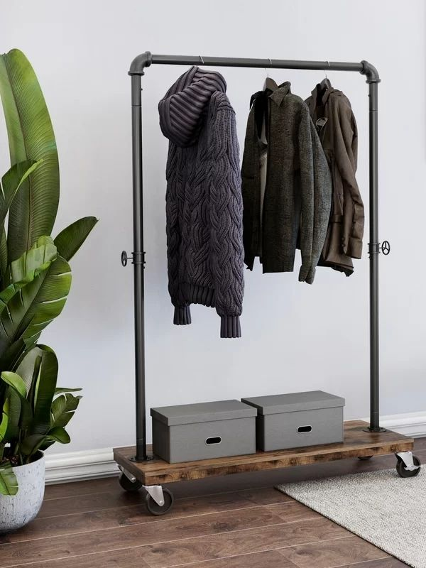 34 functional & stylish clothes racks_Movable Industrial Pipe Clothing Rack_dark brown