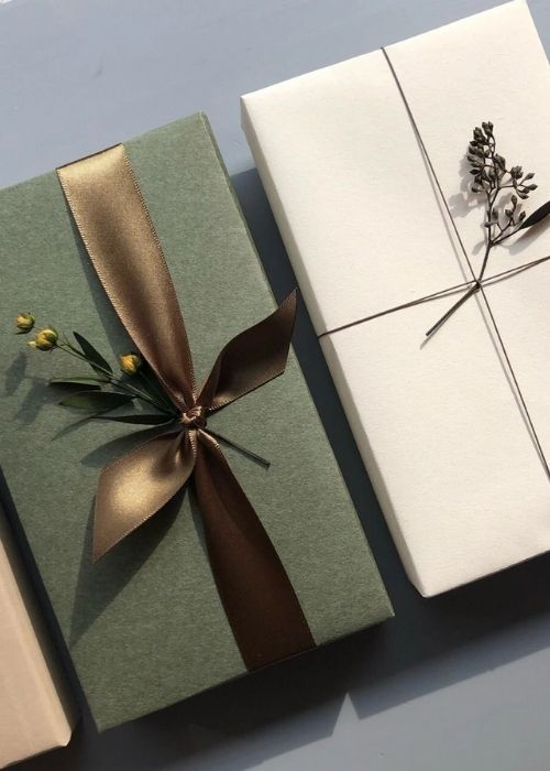minimalist green white and brown christmas packaging golden bow