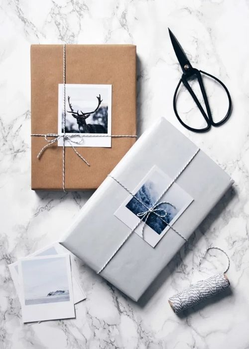 natural and silver christmas packaging with silver ribbon and pictures