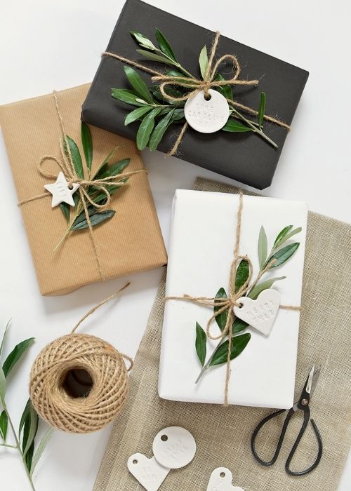 Christmas Gift Wraps_natural,black and white christmas packaging with natural, rope, greens and white figures
