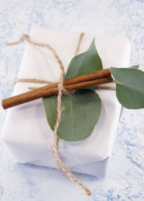 Christmas Gift Wraps_white christmas packaging with greens and cinnamon