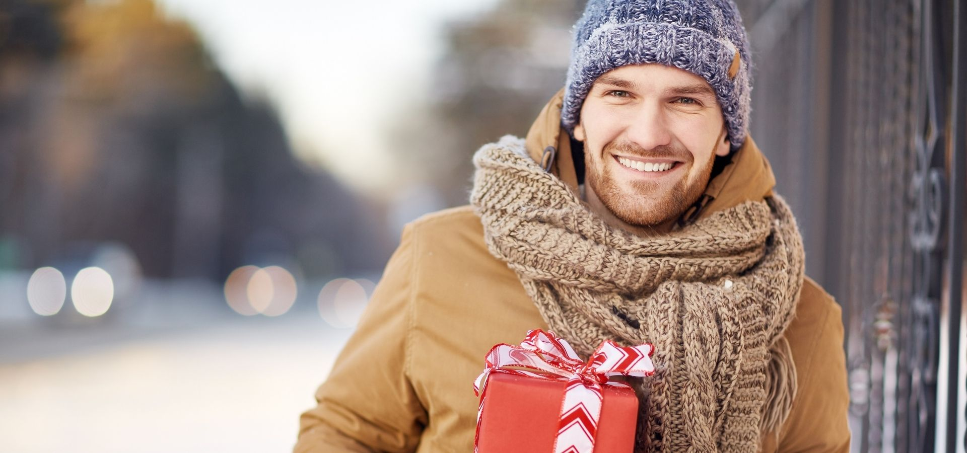 Gift Guide for Him_Boy with winter clothes and present