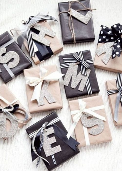 black and white christmas packaging with letters