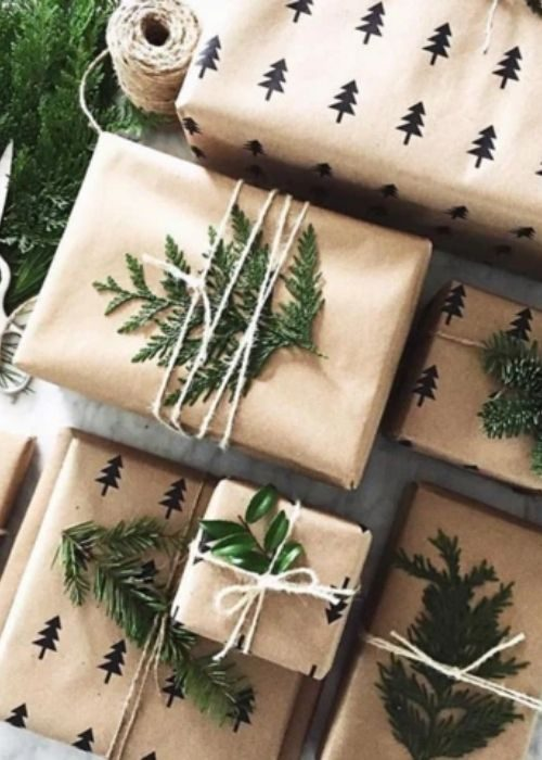 Christmas Gift Wraps_golden christmas packaging with natural rope and branches