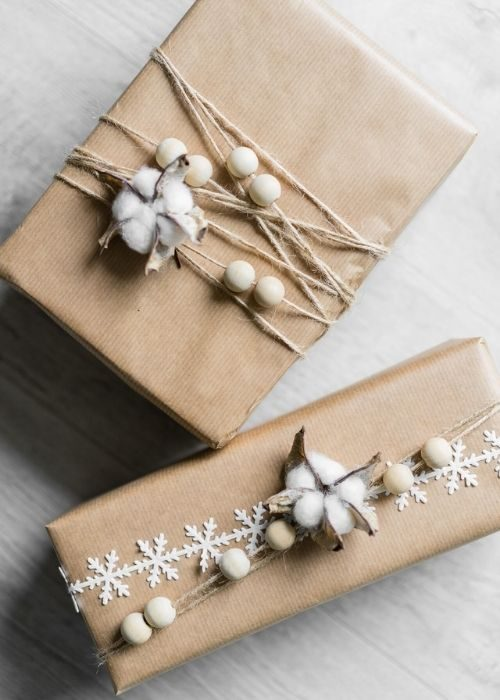 natural christmas packaging with natural robe and wooden balls and cotton decor