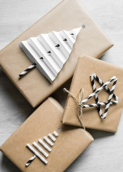 natural christmas packaging with paper and drinking straw figures