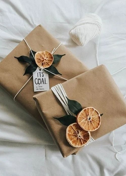 natural christmas packaging with white ribbon and orange slices