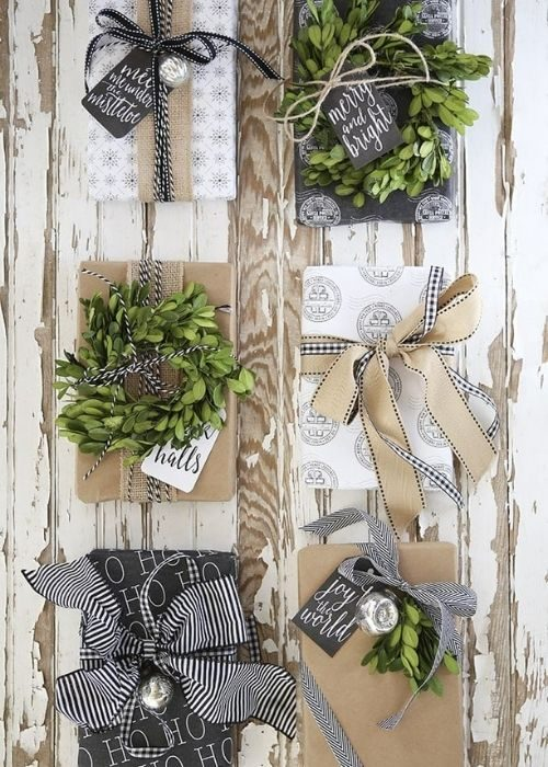 Christmas Gift Wraps_natural white and black christmas packaging with greenery and handlettering messages