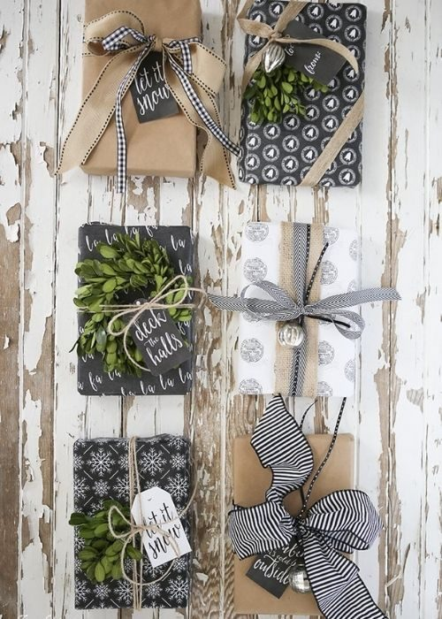 Christmas packaging_natural white and black christmas packaging with greenery, bows and handlettering messages